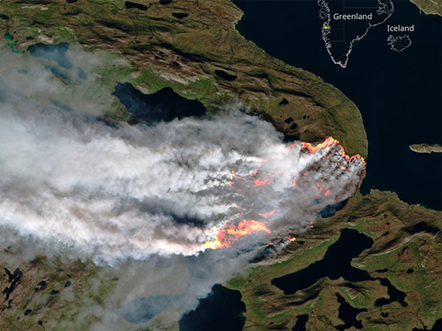 In southern Greenland, a fire that could be fueled by degraded permafrost burns 150 kilometers northeast of Sisimiut, the second-largest city in the territory. Officials aren't sure how the fire started or when it might end. This 8 August 2017 image was captured by a European Space Agency satellite in natural colors with highlights from near infrared and shortwave infrared imaging. Photo: Pierre Markuse / ESA