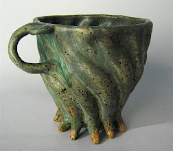 Photo: twisted mug with spiral thumb rest and 11 feet