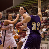 Carly Selvig, standout sophomore forward for the Lady Griz, turns the corner on Carroll's Jordan Johnston late in Tuesday's season opener.  Montana came out on top 72-45, helped along by Selvig's team-high four blocks.  Dahlberg Arena in Missoula, Mont., October 30th, 2012.