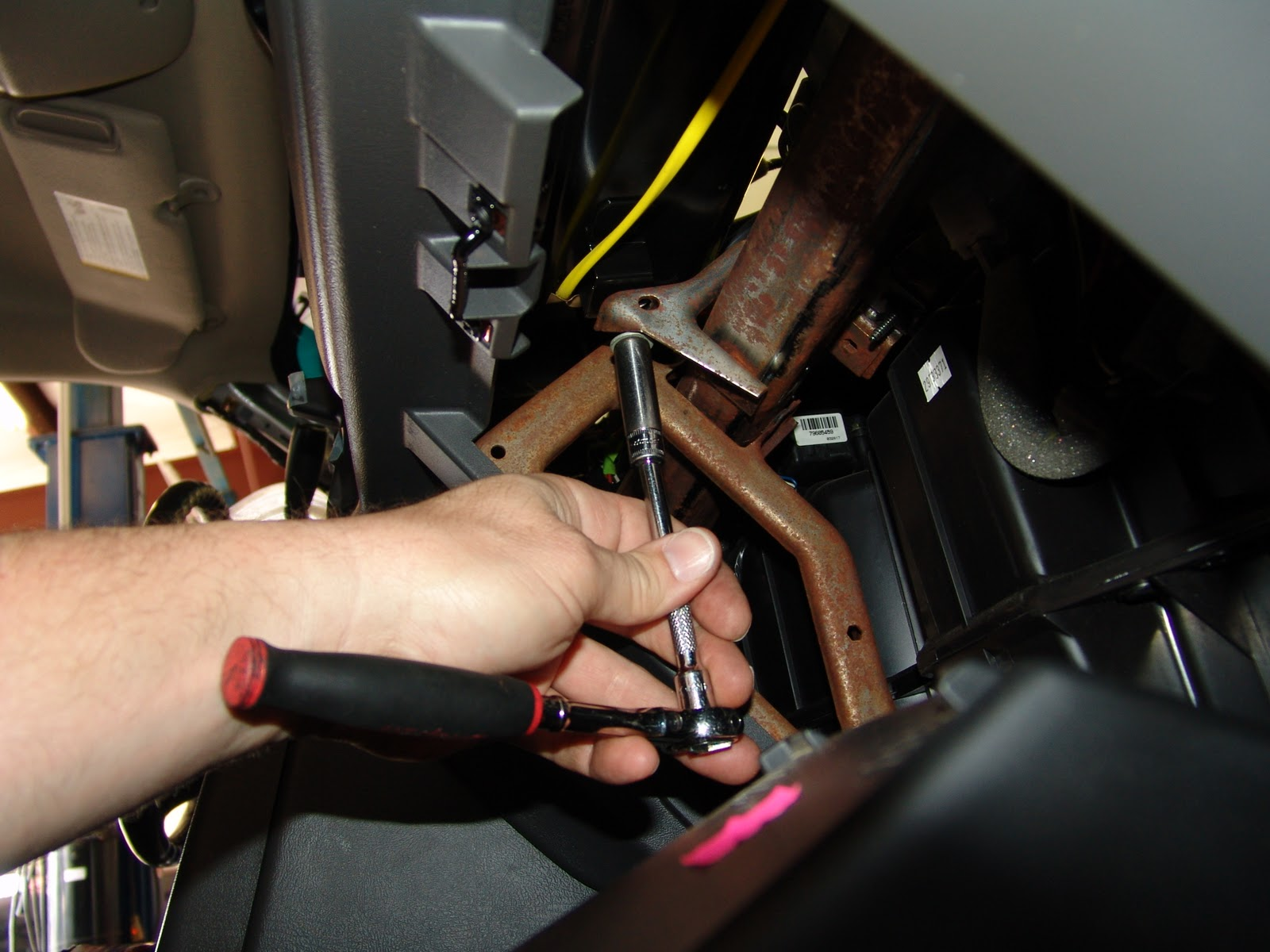 Then remove the two lower air bag screws.