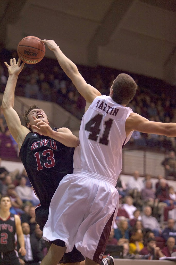 Freshman center Andy Martin blocks Eastern Washington's Thomas Reuter in the first half of Thursday's matchup.  Dahlberg Arena in Missoula, Mont., January 3rd, 2013.