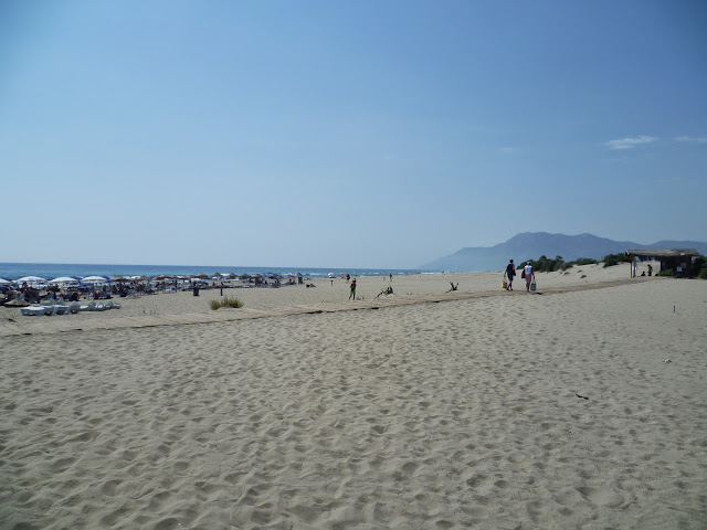 Patara Beach, showing the sunbathing area and the endless sand beyond.