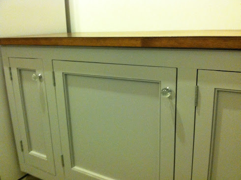 Painted pantry cabinets with glass knobs