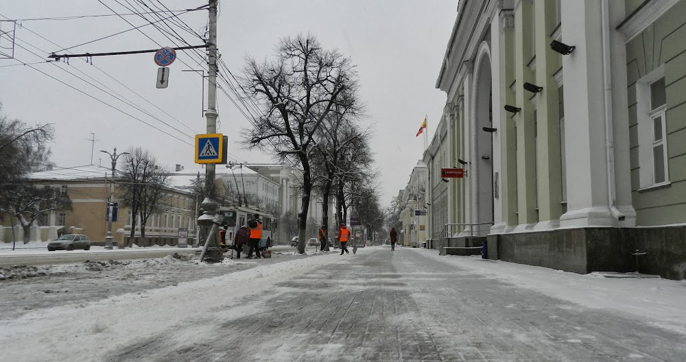 workers clear the snow off Voronezh sidewalks during an early morning blizzard