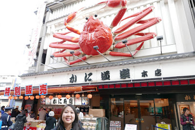 Sights of Osaka - the view down Dotonbori, including to the the crab restaurant Kani Doraku that erected their giant mechanized crab sign back in 1960 and kicked off a craze of giant animated seafood signs