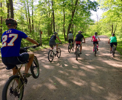 Family ride down the Maplelag driveway to Twin Lakes mtb trail