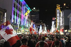 Crowds celebrating the last night of the Olympics on Granville Street