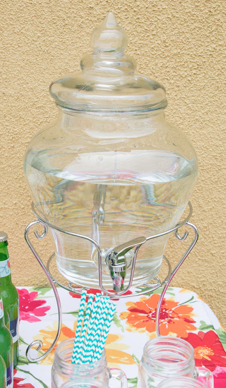 photo of a glass drink dispenser