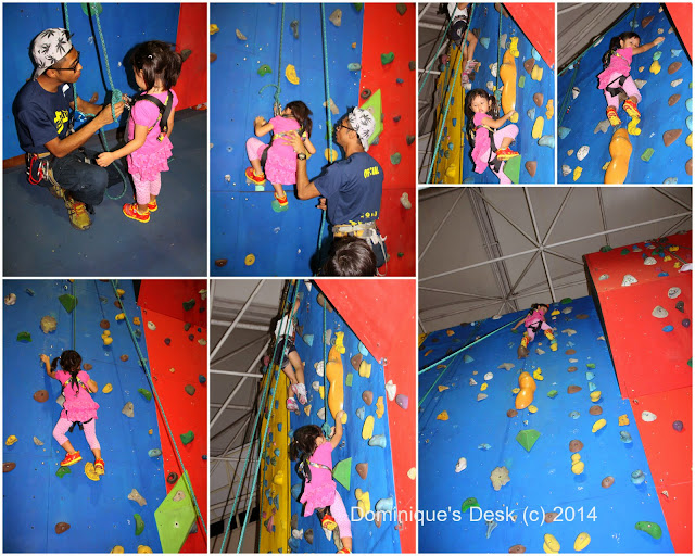 Tiger girl scaling the blue wall to the summit.