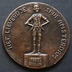 Achterkant bronzen herdedenkingspenning. Diameter 8,5 cm. Oplage 5.