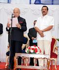 H E Governer Hansaraj Bharadwaj giving oath to MinistersChief Minister D V Sadananda Gowda seen in pic