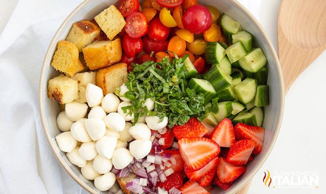 panzanella salad divided in a bowl