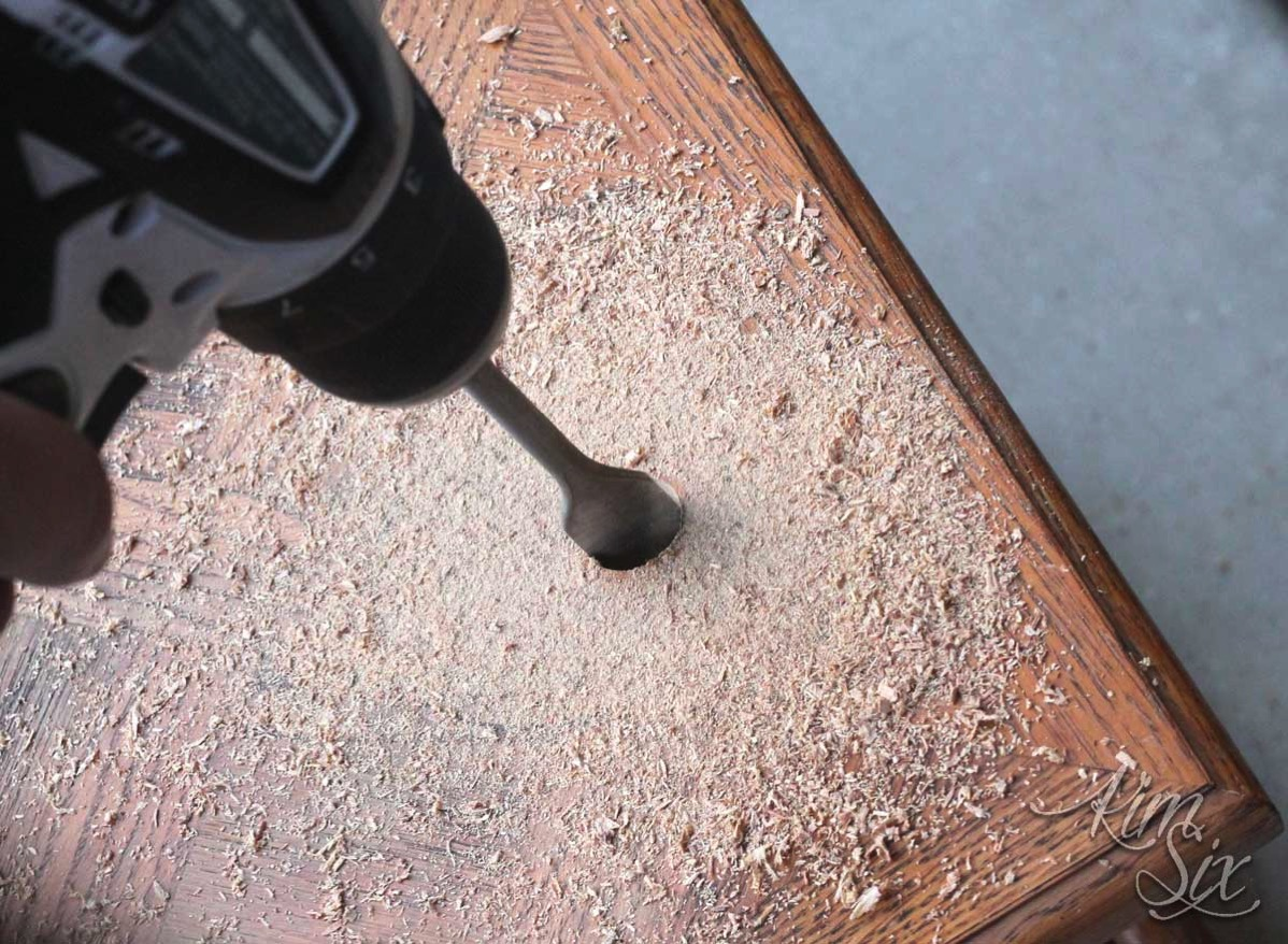 Drilling pilot hole in table