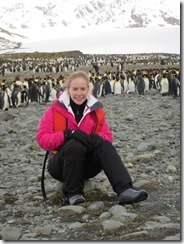 Annie sitting with penguins