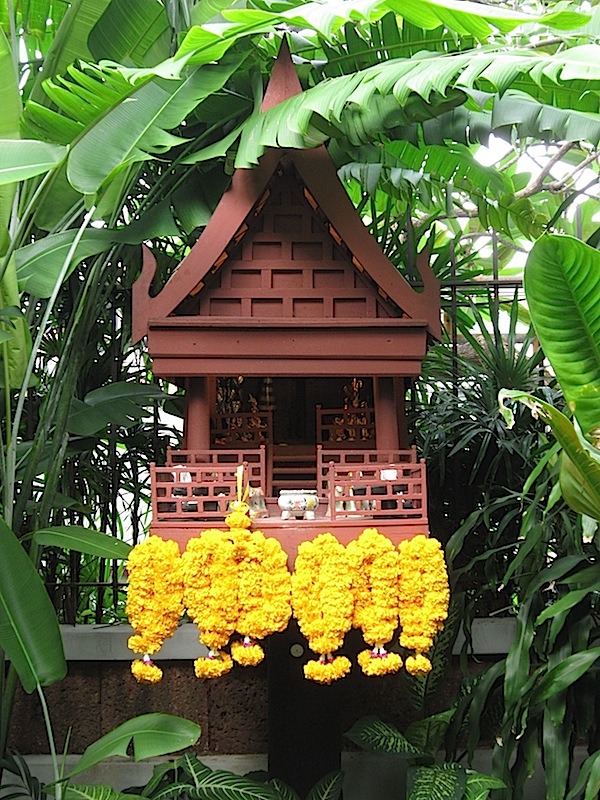 the spirit house in the garden at the Jim Thompson House in Bangkok, Thailand