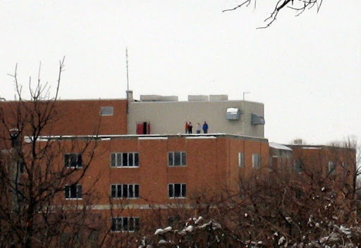 Folks on Fargo side on top of building getting good view of river
