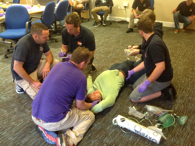 Poole, Moelfre and Clovelly crew members assessing a casualty (Suzie) on the Casualty Care Course - July 2014 Photo: Dave Riley