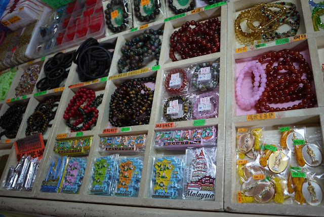 Penang magnets, bracelets, and other items for sale at a shop in Kek Lok Temple