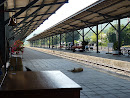 Pak Chong train station laid back relaxing sunday (after)noon - even dogs are sleepy and traditional bell on smaller thai railway stations
