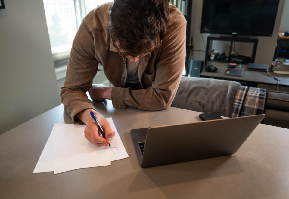 successful online business owner writing down a plan