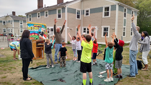 Eric having fun with the kids (and the kids having fun with Eric!)