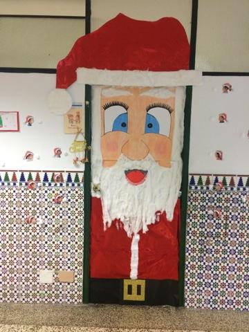 Lo aprend en infantil la navidad llega a nuestra clase for Puertas decoradas santa claus