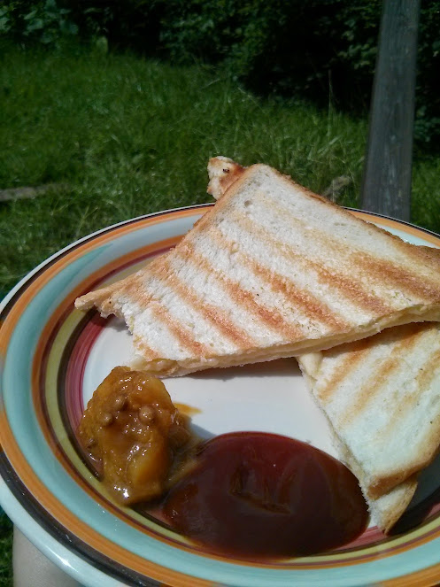 Even toasted cheese sandwiches go well with mango pickle