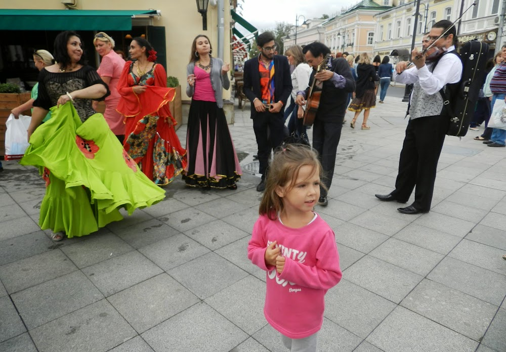 a little girl enjoys a gypsy performance