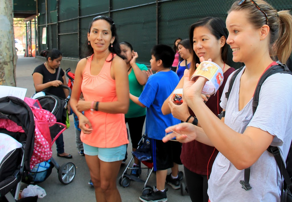 Mary Chen and Cassie Burley hand out stickers for kids with reusable water bottles