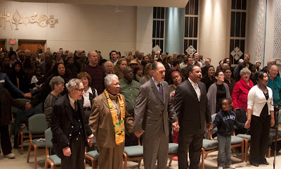 Singing of 'We Shall Overcome'...everyone holding hands and enough beautiful voices for this familiar tune. At front is Rev Dr. Edna Thomas, former state senator Arnold Brown, Teaneck board of Ed President Dr. Ardie Walser and Tyree Grant    Photos by TOM HART.
