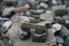 An inunnguaq marking Crypt Lake trail