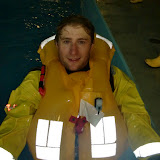 31 May 2012 - Crew Member Ed Davies exits the pool after trying out the new lifejacket Photo: RNLI Poole/Dave Riley
