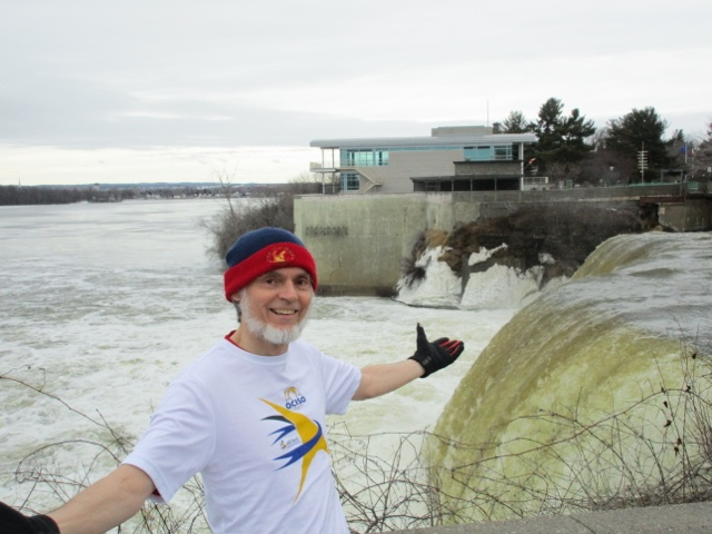 David Rain, tenor, stands in front of the Rideau Falls, Ottawa