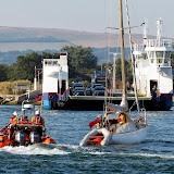 The ILB escorts the yacht past the chain ferry at the entrance to Poole Harbour - 8 August 2013.   Photo: Kevin Mitchell, Maritime Images