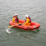 Not sure they'll make the Oxford and Cambridge Blues team but Steve (cox) provides Graham (rowing) with directions to race around the all-weather lifeboat! 6 April 2014 Photo: RNLI Poole/Anne Millman