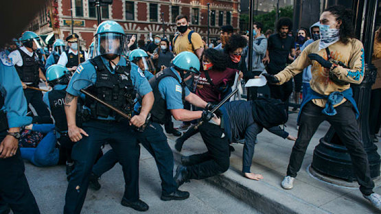 Photo of police rioting violently against people protesting the police murder of George Floyd.