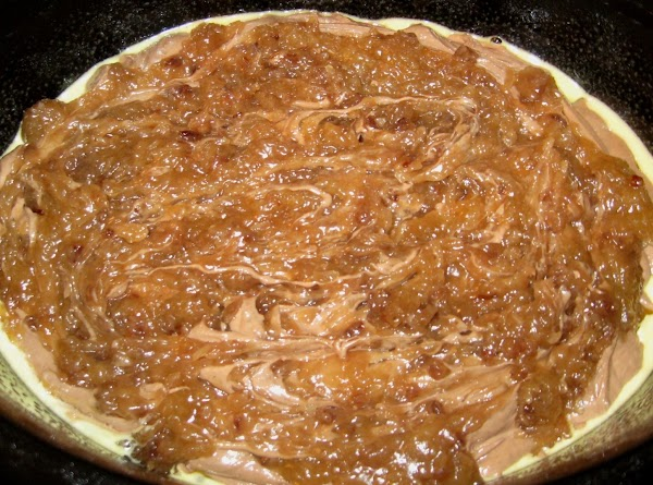 Mix together the cake mix, melted butter, buttermilk, chocolate syrup, and eggs.  Beat...