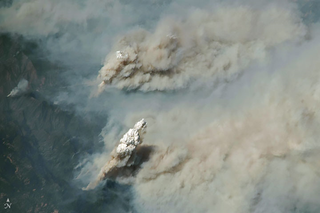 A pyrocumulus cloud rises from the Ferguson fire near Yosemite National Park on 2 August 2018, viewed from the International Space Station. The park service closed Yosemite Valley and other parts of the park due to heavy smoke. Photo: Joshua Stevens / NASA Earth Observatory