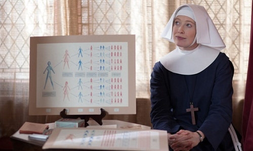Sister Winifred sitting by a diagram about contraception