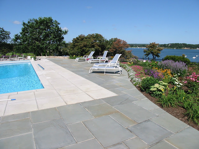 In-ground pool with lighter color paving for hot summer days