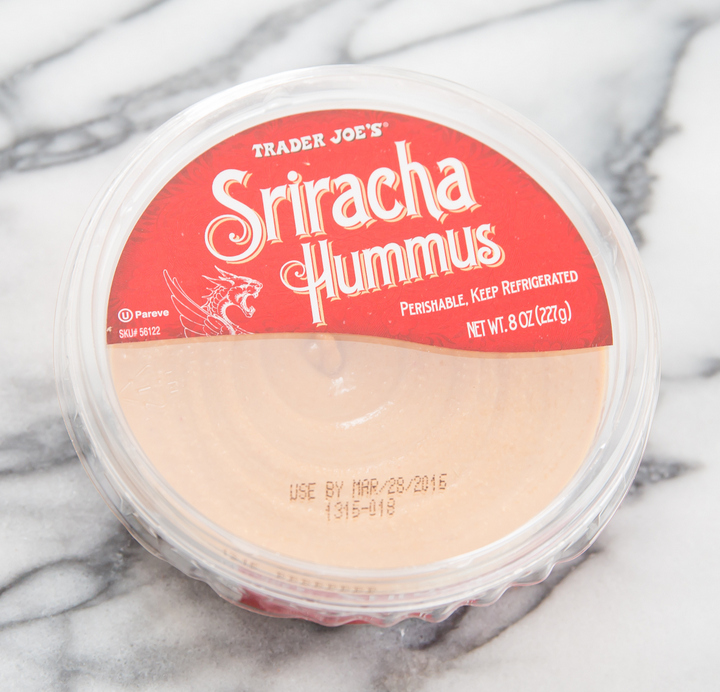 overhead photo of a package of Sriracha Hummus