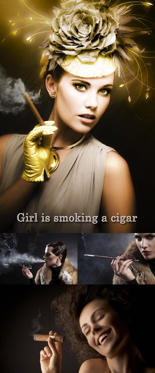 Stock Photo: Girl is smoking a cigar