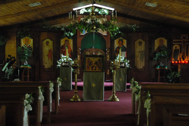 The Church was beautifully decorated with greens for the feast of Pentecost, as well as flowers for the wedding.