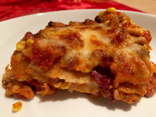 Mexican tortilla lasagna with chicken enchillada sauce