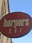 Harpers Bar sign red oval with straight font evoking music score mark-up
