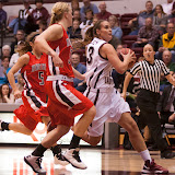 Senior forward Alexandra Hurley on a fast break late in the first period of Monday's victory over Minot State.  Hurley is pursued by Beavers Amanda Sansaver (#5) and Sarah Lester.  Dahlberg Arena in Missoula, Mont., November 5th, 2012.