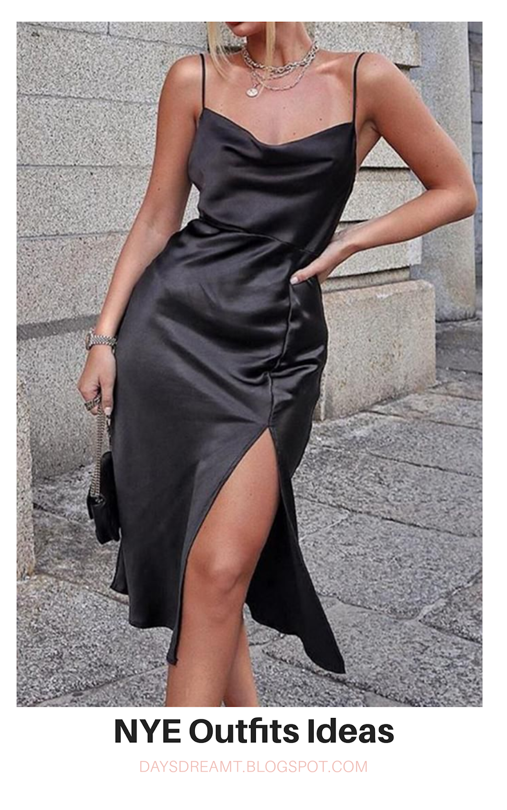 Woman in black satin slip dress with slit on the side