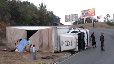 Flipped truck on the road up to Chichi. The road in and out of Chichi goes up and down thru a canyon with 30' turn radius at a 30 percent slope...We thank Victor for his safe driving. Photos by TOM HART