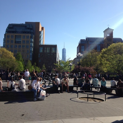 Freedom Tower of Lower Manhattan, view from Washington Square Park in the Village,  with perfect sunbeam! And a contented crowd or park-goers.