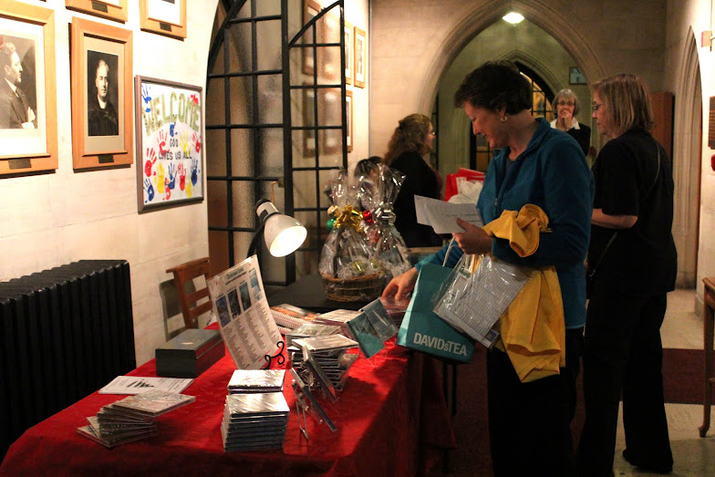 Susan checks on the CD table at a concert